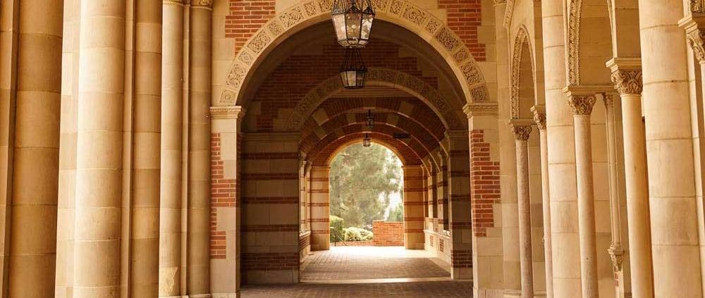 college passageway columns bricks lamps